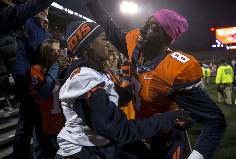 Illinois Fighting Illini wide receiver Geronimo Allison (8) is greeted by his girlfriend, Jahne Dorsey, left, as he celebrates the Illini's 14-13 victory over Nebraska at Memorial Stadium, Saturday, Oct. 3, 2015, in Champaign, Ill. Justin L. Fowler/The State Journal-Register