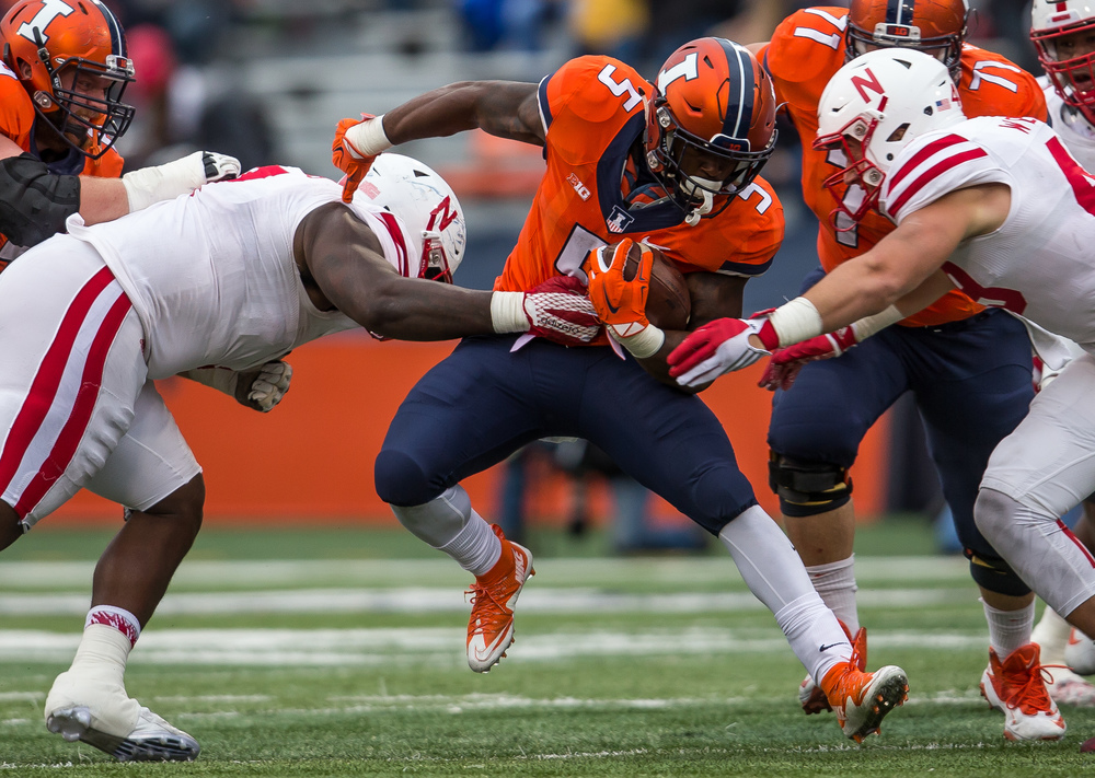 Illinois Fighting Illini running back Ke'Shawn Vaughn (5) gets wrapped up by Nebraska Cornhuskers defensive tackle Maliek Collins (7)and linebacker Chris Weber (49) in the third quarter at Memorial Stadium, Saturday, Oct. 3, 2015, in Champaign, Ill. Justin L. Fowler/The State Journal-Register