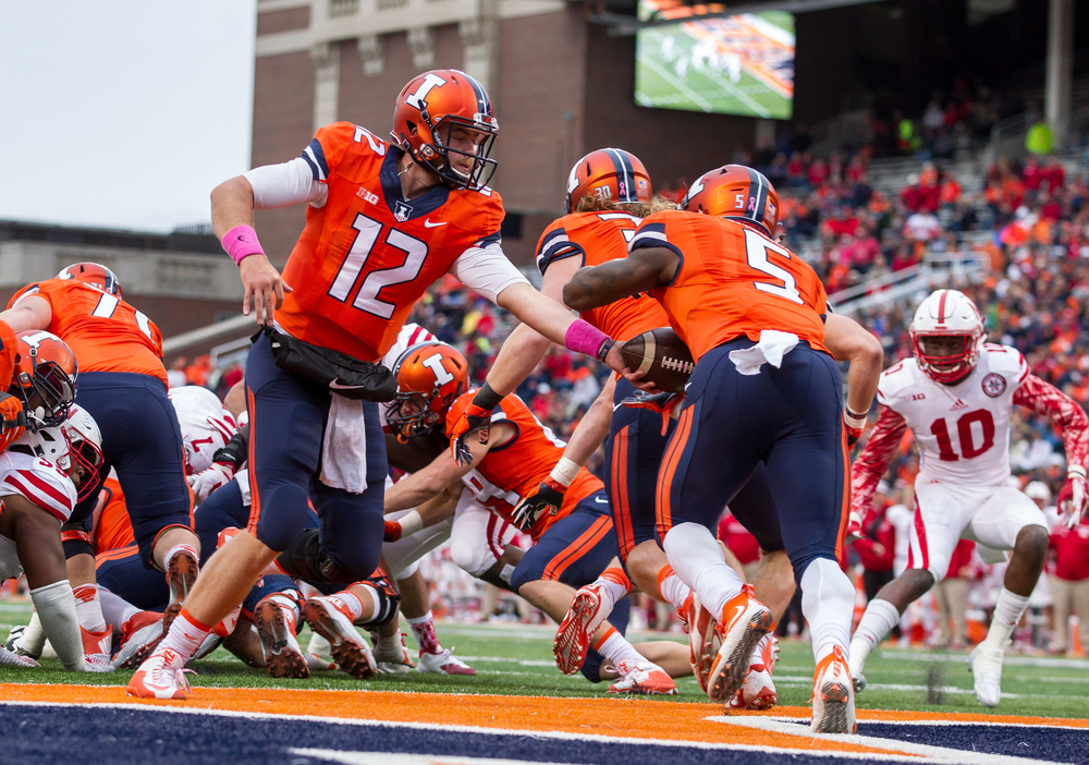 Illinois Fighting Illini quarterback Wes Lunt (12) hands the ball off to running back Ke'Shawn Vaughn (5) in the end zone as the Illini were pinned by Nebraska in the third quarter at Memorial Stadium, Saturday, Oct. 3, 2015, in Champaign, Ill. Justin L. Fowler/The State Journal-Register