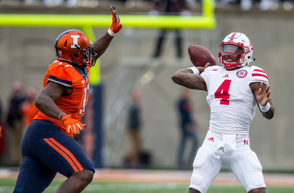 Nebraska Cornhuskers quarterback Tommy Armstrong Jr. (4) winds up to pass under pressure from Illinois Fighting Illini defensive lineman Jihad Ward (17) in the third quarter at Memorial Stadium, Saturday, Oct. 3, 2015, in Champaign, Ill. Justin L. Fowler/The State Journal-Register