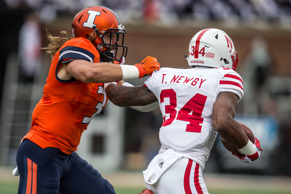 Illinois Fighting Illini defensive back Taylor Barton (3 wraps up Nebraska Cornhuskers running back Terrell Newby (34) on a rush in the first quarter at Memorial Stadium, Saturday, Oct. 3, 2015, in Champaign, Ill. Justin L. Fowler/The State Journal-Register