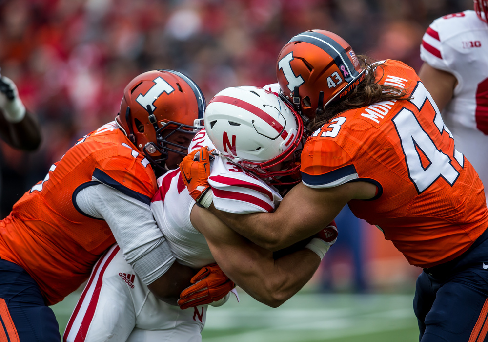 Illinois Fighting Illini defensive end Dawuane Smoot (91) and linebacker Mason Monheim (43) wrap up Nebraska Cornhuskers fullback Andy Janovich (35) on a rush in the first quarter at Memorial Stadium, Saturday, Oct. 3, 2015, in Champaign, Ill. Justin L. Fowler/The State Journal-Register