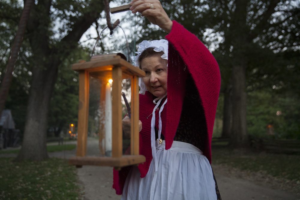 Sharon Knope lights candles before the start of the annual Candlelight Walk at New Salem State Historic Site Friday, Oct. 2, 2015. Rich Saal/The State Journal-Register