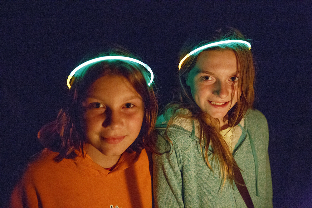 Brylee Morris, left, and Madison Ritz wore glowing halo rings to the annual Candlelight Walk at New Salem State Historic Site Friday, Oct. 2, 2015. Rich Saal/The State Journal-Register