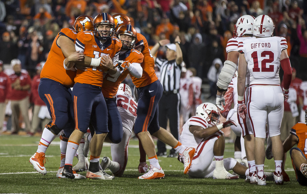 Illinois Fighting Illini place kicker Taylor Zalewski (17) is mobbed by his teammates after making the extra point to give the Illini the lead 14-13 over Nebraska with seconds left in the fourth quarter at Memorial Stadium, Saturday, Oct. 3, 2015, in Champaign, Ill. Justin L. Fowler/The State Journal-Register