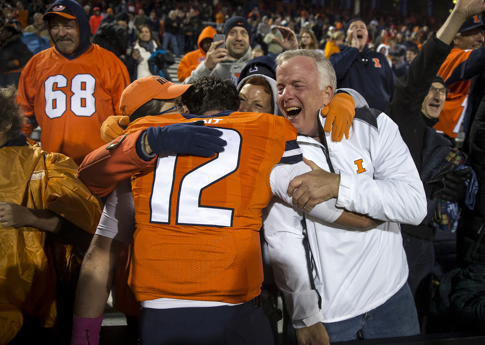 Illinois Fighting Illini quarterback Wes Lunt (12) is swarmed by his family after the Illini defeated Nebraska 14-13 at Memorial Stadium, Saturday, Oct. 3, 2015, in Champaign, Ill. Justin L. Fowler/The State Journal-Register