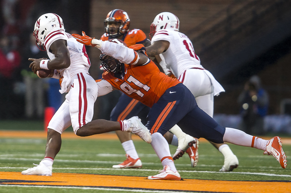 Illinois Fighting Illini defensive end Dawuane Smoot (91) brings down Nebraska Cornhuskers quarterback Tommy Armstrong Jr. (4) for a loss of 15 yards in the fourth quarter at Memorial Stadium, Saturday, Oct. 3, 2015, in Champaign, Ill. Justin L. Fowler/The State Journal-Register