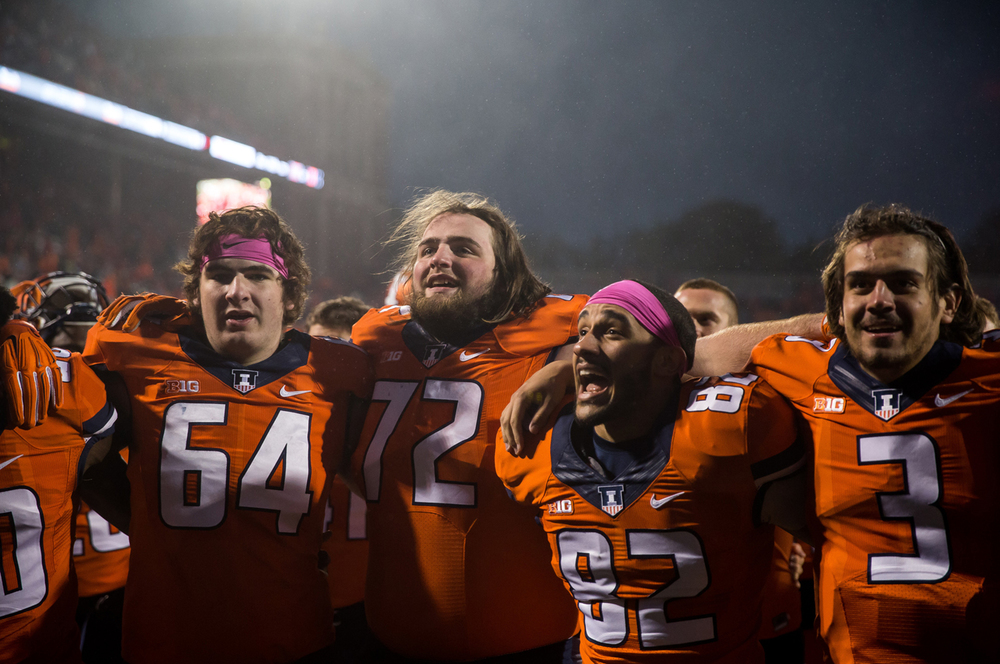 Illinois Fighting Illini offensive lineman Gabe Megginson (72) and his teammates gather together to celebrate the Illini's 14-13 victory over Nebraska at Memorial Stadium, Saturday, Oct. 3, 2015, in Champaign, Ill. Justin L. Fowler/The State Journal-Register