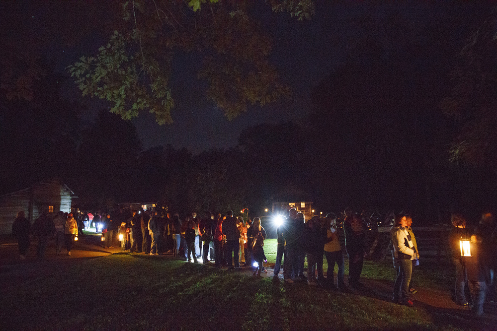People wait in line to walk through the Rutledge Tavern for a taste of gingerbread and cider during the annual Candlelight Walk at New Salem State Historic Site Friday, Oct. 2, 2015. Rich Saal/The State Journal-Register