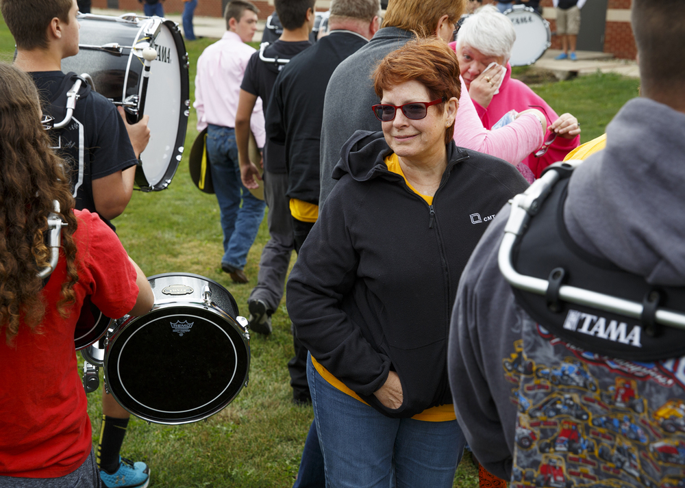 Robert Sanders' wife, Peggy, watches as members of the A-C Central High School band drum line leave the field after the balloon launch Friday, Oct. 9, 2015. Robert Sanders, the school's principal, died Wednesday. Rich Saal/The State Journal-Register