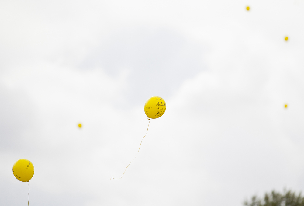 Balloons launched in memory of Robert Sanders float toward the sky at A-C Central Middle and High School Friday, Oct. 9, 2015. Sanders, the schools' principal, died Wednesday. Rich Saal/The State Journal-Register