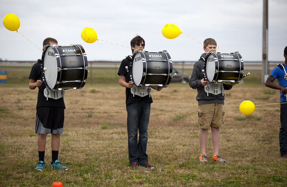 The A-C Central High School band's drum line performed before a balloon launch at the school Friday, Oct. 9, 2015 to honor school principal Robert Sanders, who died Wednesday. Rich Saal/The State Journal-Register
