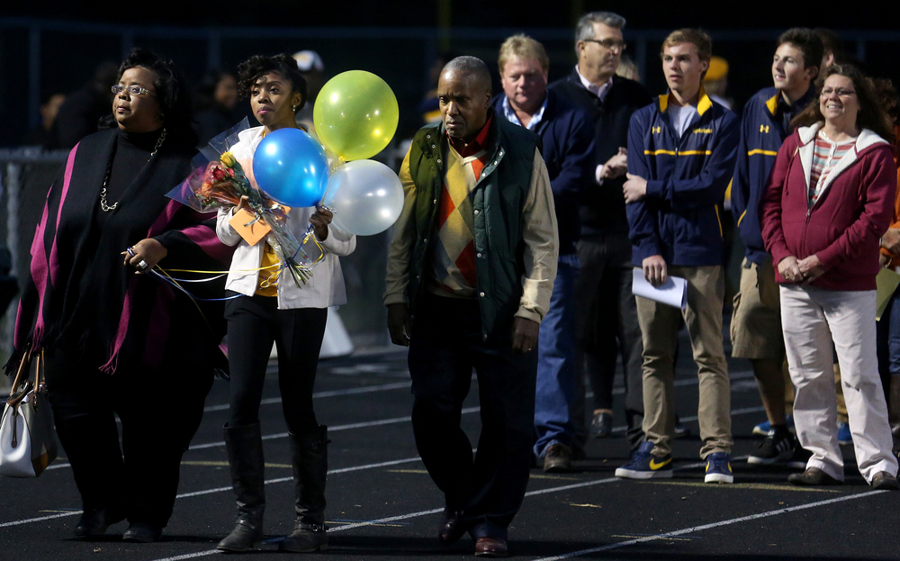 It was Senior Night at Spartans Field, with senior athletes honored with floral bouquets and flowers while family members escorted the athletes in front of the bleachers after names were announced. David Spencer/The State Journal-Register