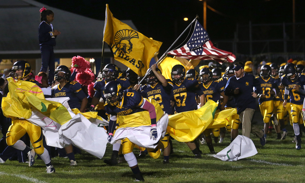 The Spartans take the field for the first time. David Spencer/The State Journal-Register