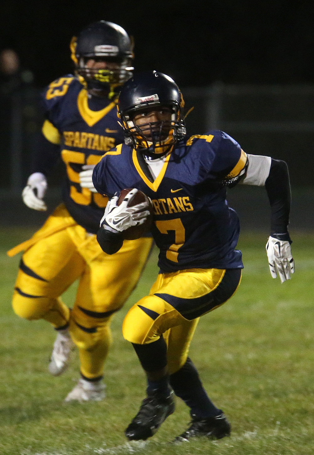 Spartans ball carrier Simeon Helem runs for yardage. David Spencer/The State Journal-Register