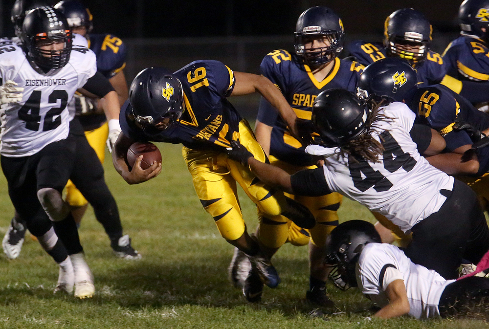 Spartans ball carrier Edwin Gailes picks up yardage under heavy pressure late in first half action. David Spencer/The State Journal-Register