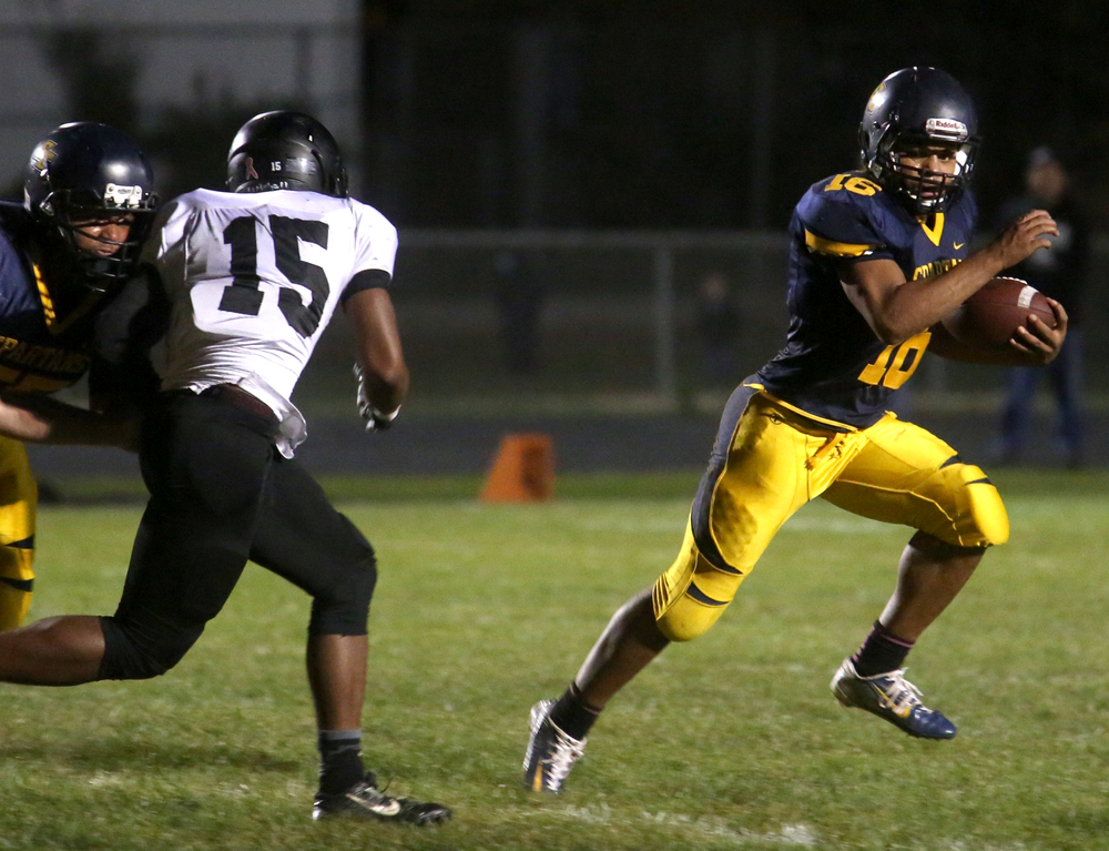 Spartans ball carrier Edwin Gailes sprints for yardage Friday night. David Spencer/The State Journal-Register