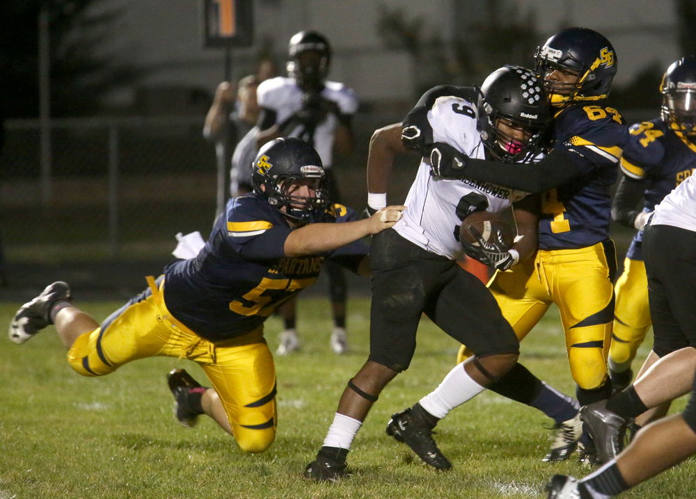 Panthers ball carrier Salat Al-Nurridin runs into Spartans defenders Colton Simpson at left and Antonio Lewis. David Spencer/The State Journal-Register