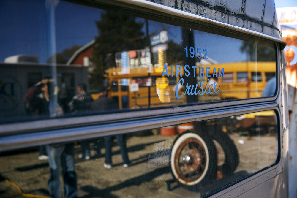 The line of customers registering for an auction at Shea's Gas Station and Museum in Springfield is reflected in the window of a 1952 Airstream Cruiser trailer Saturday, Oct. 10, 2015. The trailer was auctioned along with other miscellaneous memorabilia during the first of three auctions at the site. Ted Schurter/The State Journal-Register