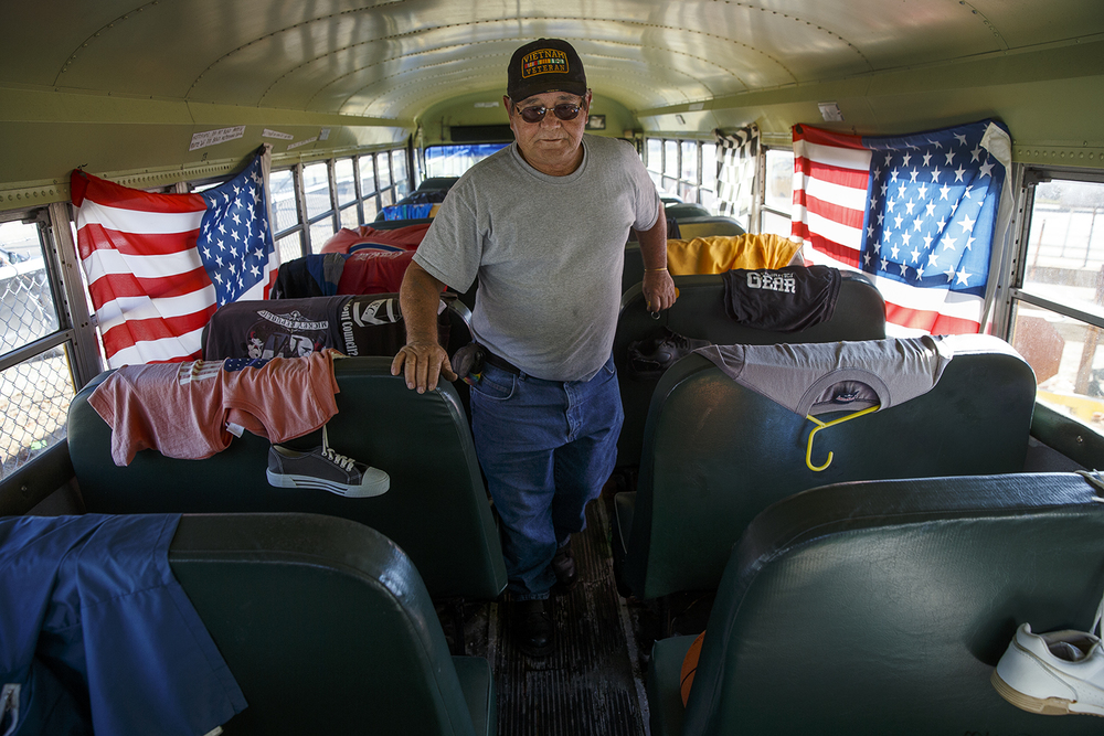 Bill Shea Jr. walks the aisle of the school bus at Shea's Gas Station and Museum in Springfield after unlocking the front door for visitors before the auction Saturday, Oct. 10, 2015. The Route 66 landmark first opened in 1995 at 2075 Peoria Road by Bill Shea, who passed away in December 2013. Ted Schurter/The State Journal-Register