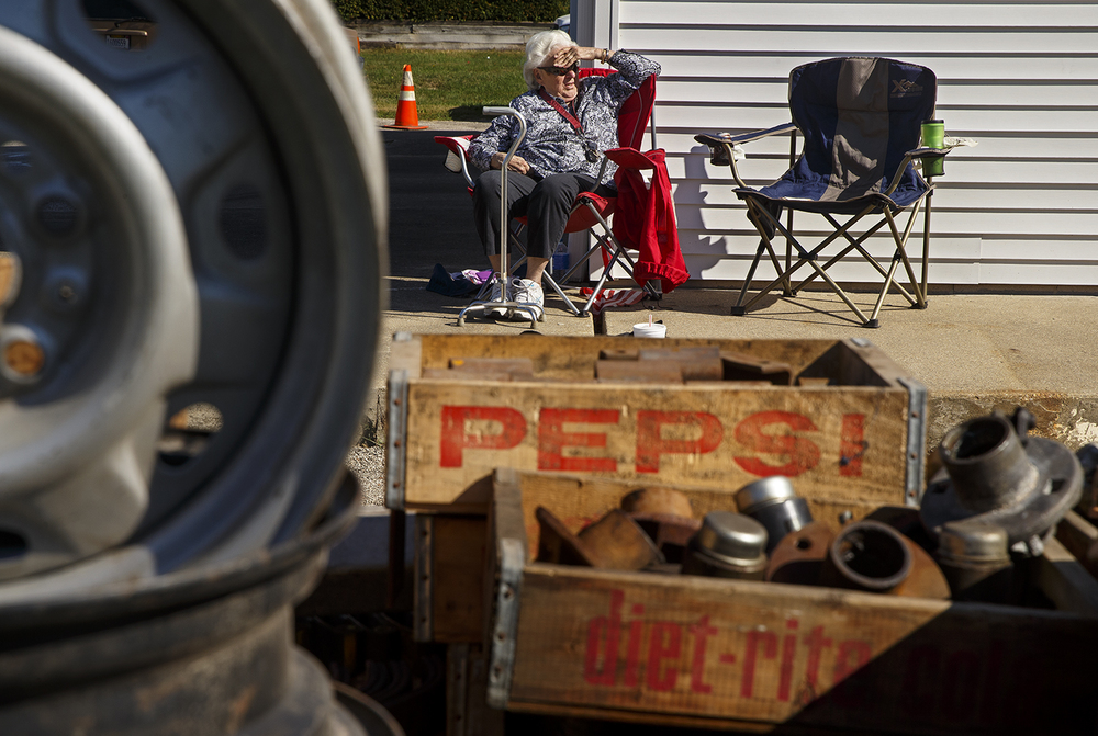 Henrietta Sisk watches the auction of items from at Shea's Gas Station and Museum in Springfield Saturday, Oct. 10, 2015. The Route 66 landmark first opened in 1995 at 2075 Peoria Road by Bill Shea, who passed away in December 2013. Ted Schurter/The State Journal-Register