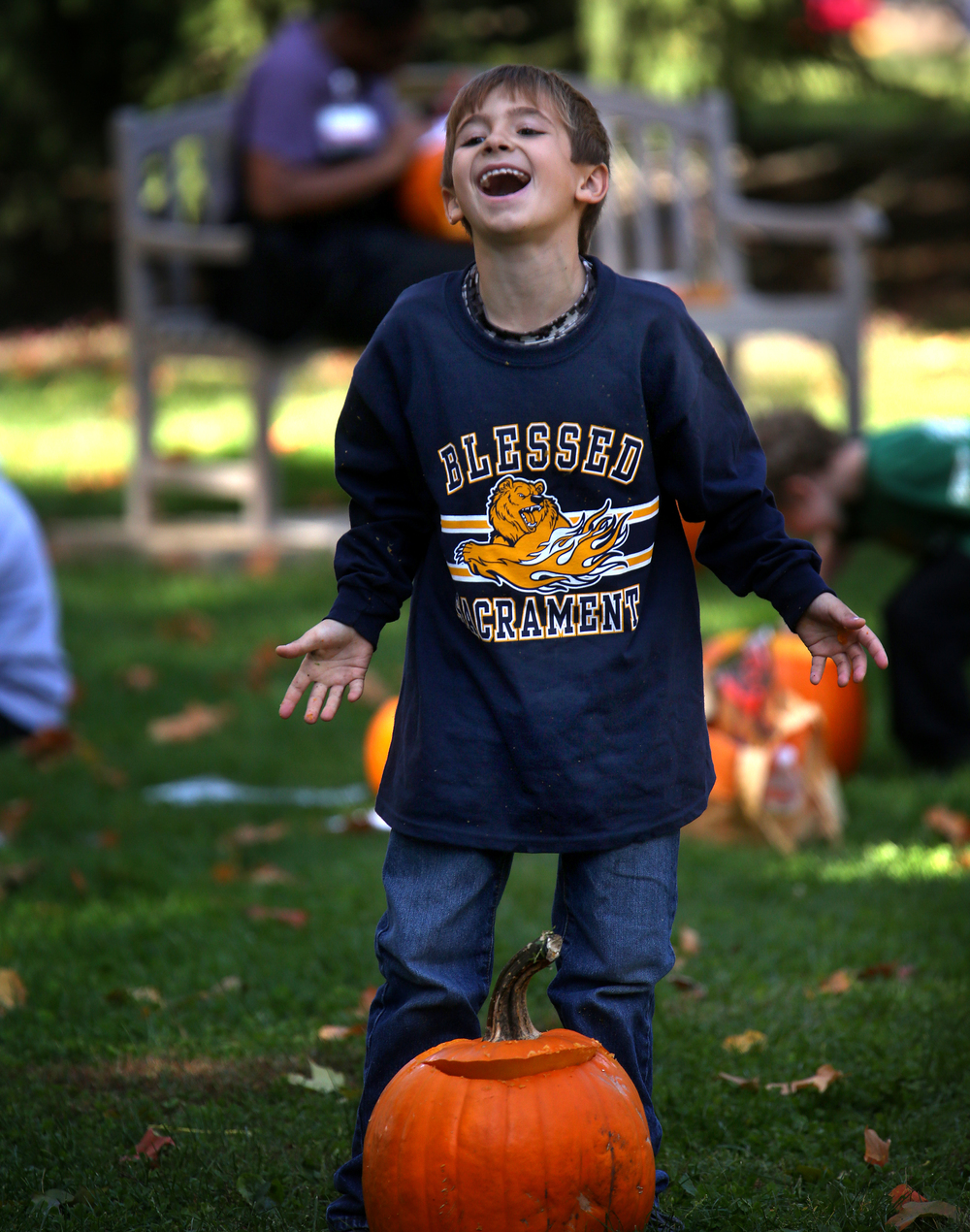 "The residue of slimy pumpkin ""guts"" made it a laughing matter for Tyler Verry, 6, of Springfield, who had this pumpkin slip out of his hands while transporting it to where he was going to carve it Saturday morning. David Spencer/The State Journal-Register"
