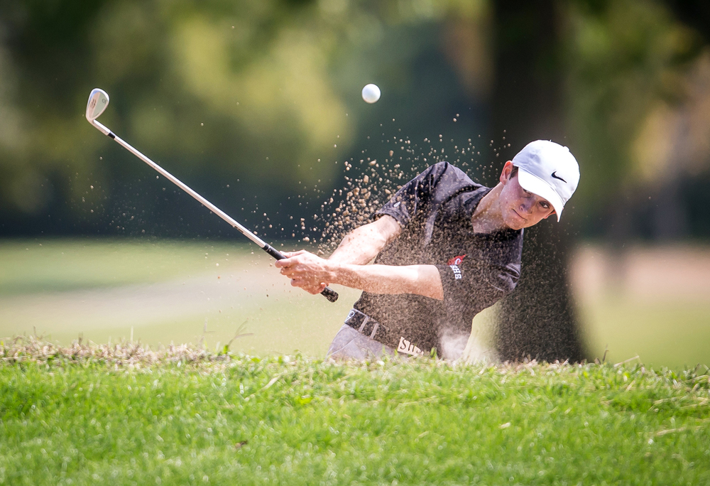 Springfield's Bailey Gill hits out of the sand up to the green on the No. 12 hole during the Boys Class 2A Springfield Regional at Lincoln Greens Golf Course, Tuesday, Oct. 6, 2015, in Springfield, Ill. Gill won the individual regional title shooting a two under 70. Justin L. Fowler/The State Journal-Register