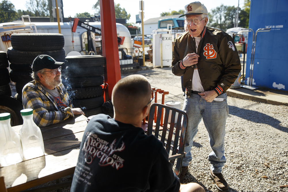 """I wouldn't walk across the street to see the Cardinals,"" Bob McLean scoffed as he showed Jared Baker his St. Louis Browns jacket while visiting at Shea's Gas Station and Museum in Springfield Saturday, Oct. 10, 2015. McLean, and his son John, left, were at Shea's for an auction of some of the contents of Shea's. The Browns moved to Baltimore after the 1953 baseball season. Ted Schurter/The State Journal-Register"