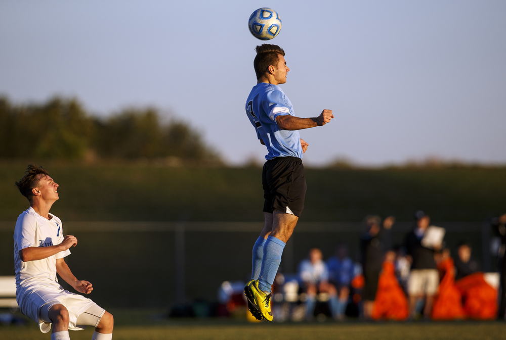 North Mac's Joseph-Catanzaro-Carlile leaps to head the ball in front of Lutheran's Riley O'Connell during the Class 1A Riverton Regional Tuesday, Oct. 13, 2015. Ted Schurter/The State Journal-Register