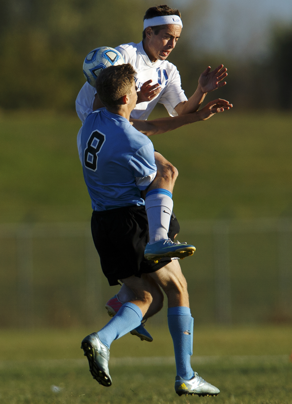North Mac's Jacob Bounds and Lutheran's Steven Cowles collide during the Class 1A Riverton Regional Tuesday, Oct. 13, 2015. Ted Schurter/The State Journal-Register