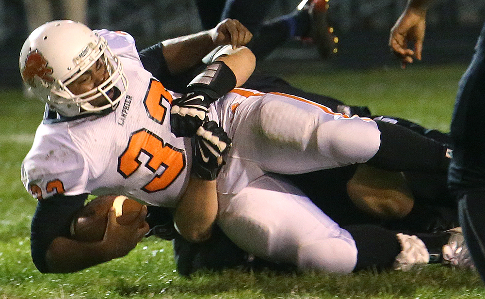 Lanphier ball carrier Reggie Dickerson is brought down by a Springfield defender after racking up yards in the first half Friday night. David Spencer/The State Journal-Register