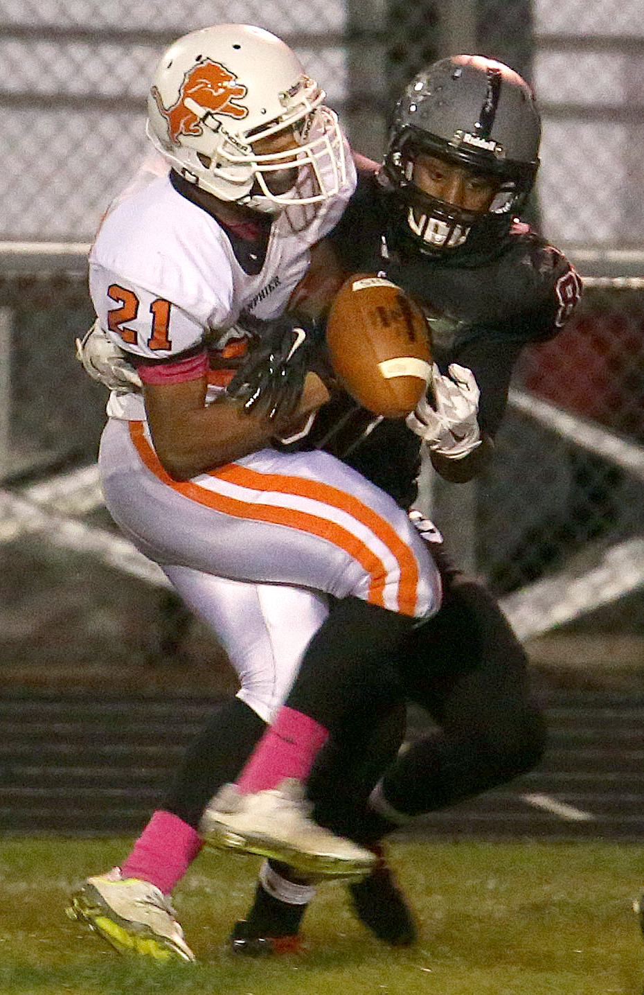 Lanphier defender Cameron Smith at left breaks up a long pass near the goal line intended for Senators receiver Cameron Jones that was eventually intercepted by Smith's teammate Elijah Forshee. David Spencer/The State Journal-Register