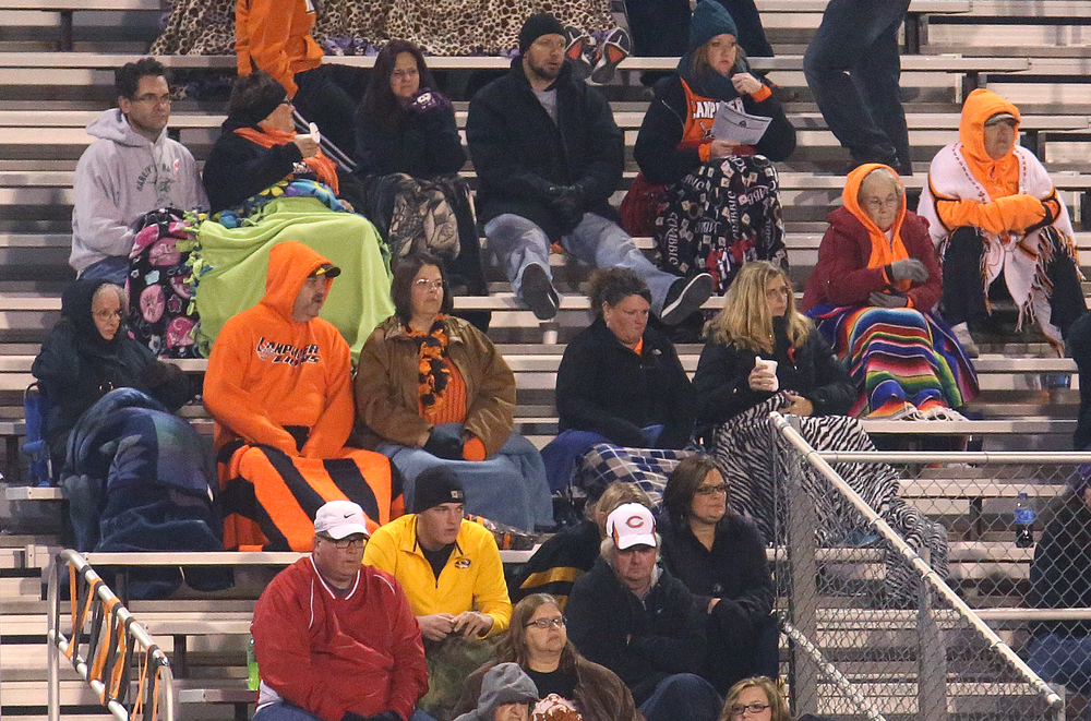 Blankets and warm bleacher gear was in abundance on the Lanphier side of the bleachers Friday night. David Spencer/The State Journal-Register