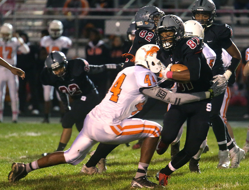 Springfield ball carrier Cameron Jones runs into Lanphier defender Dejoiur Burns. David Spencer/The State Journal-Register