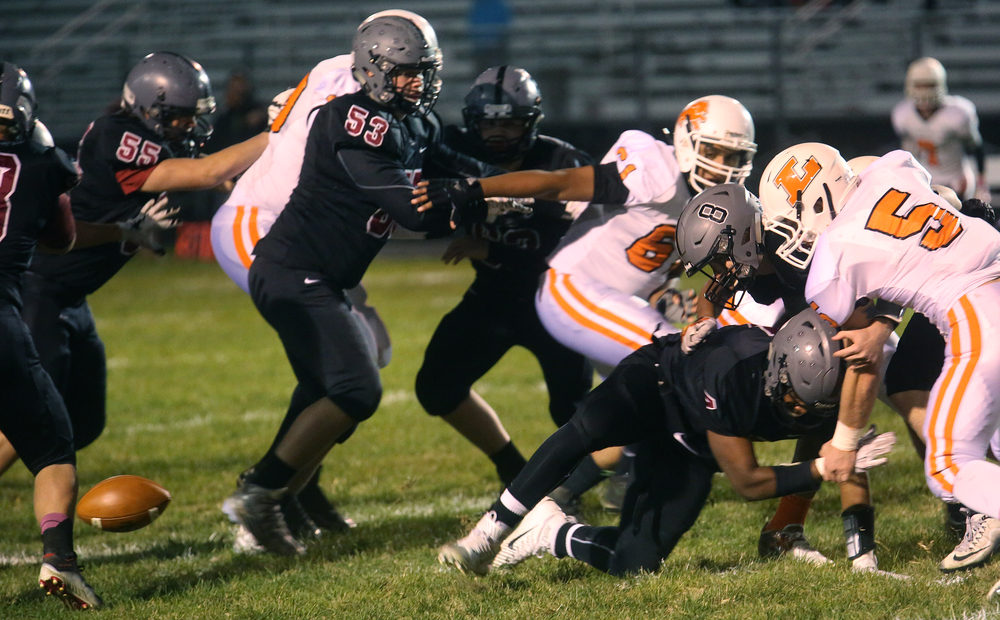 This fumble by Springfield quarterback Jackson Shearer in the first quarter lead to Lanphier's first touchdown of the night. David Spencer/The State Journal-Register