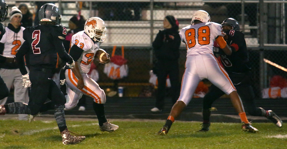 Lanphier ball carrier Reggie Dickerson runs for yardage during the first half. David Spencer/The State Journal-Register