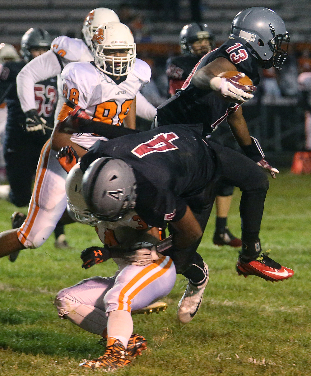 Senators ball carrier Jubbar Cross goes airborne while sprinting for his team's first touchdown of the night. Defending on the play is Rahkeem Hawkins. David Spencer/The State Journal-Register