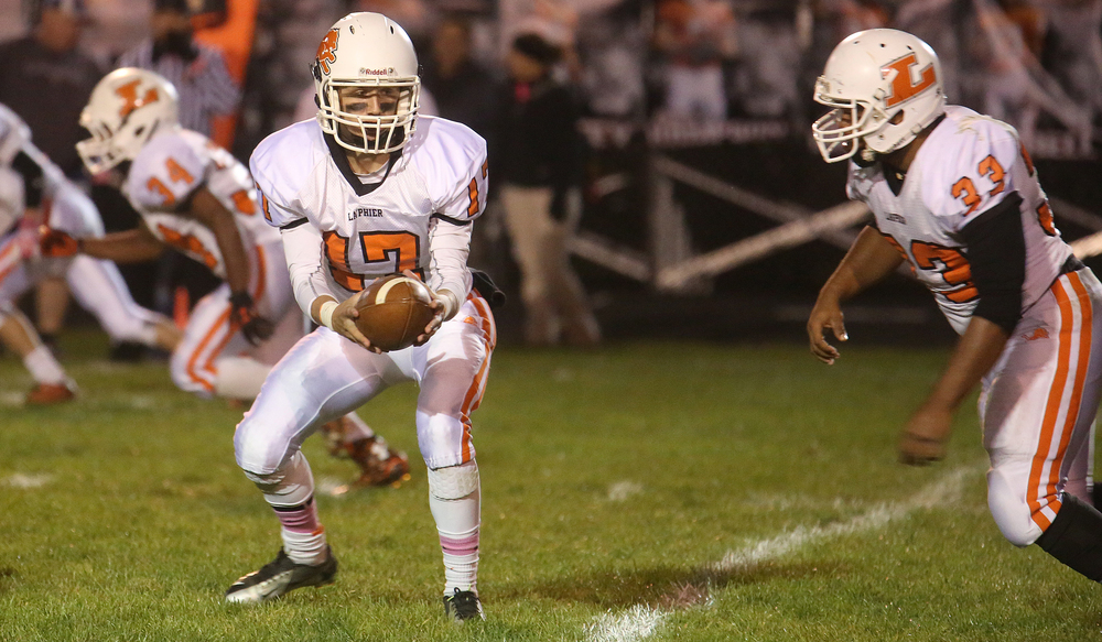 Lanphier quarterback Joe Varela prepares to hand off the ball to teammate Reggie Dickerson who ran for 123 yards in first half action. David Spencer/The State Journal-Register