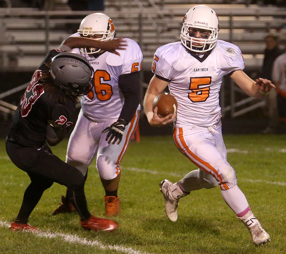 Lanphier ball carrier Chase Hampson runs for the successful conversion after teammate Davon Harris scored.  David Spencer/The State Journal-Register
