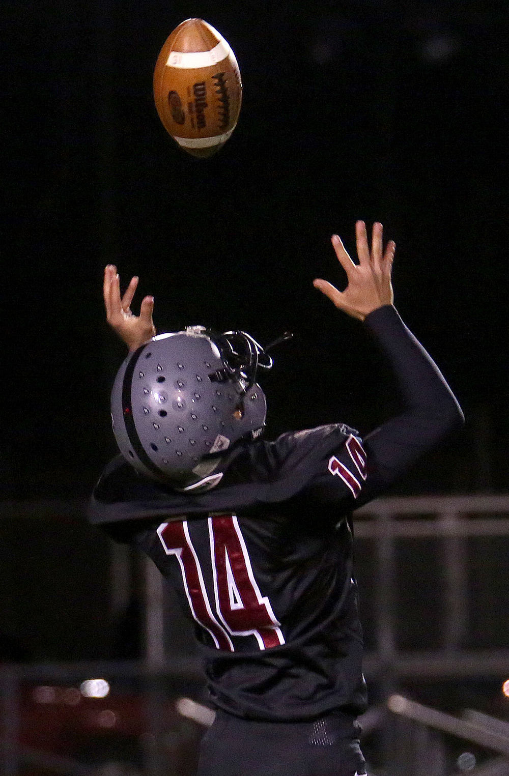 Springfield punter Matt Severino prepares to pull in a snap that went a bit high before kicking it away during first half action. David Spencer/The State Journal-Register