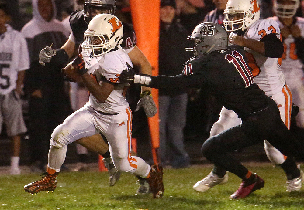 Lanphier ball carrier JacAnthony Childress escapes the reach of Springfield defender Peyton West in route to scoring a touchdown Friday night. David Spencer/The State Journal-Register