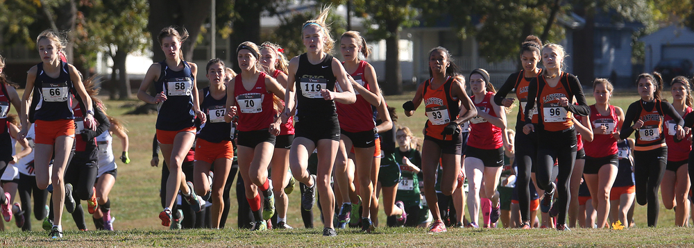 Runners in the girls race take off from the starting line Saturday morning. Eventual winner Katherine Petty of Rochester is at far left of frame. David Spencer/The State Journal-Register