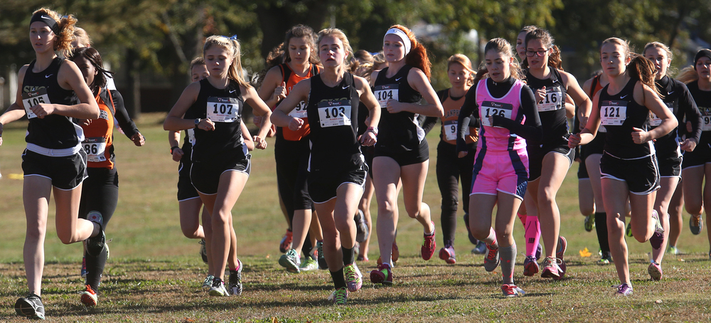 Runners, many from the Sacred Heart Griffin team, take off from the starting line in the girls race Saturday morning. David Spencer/The State Journal-Register