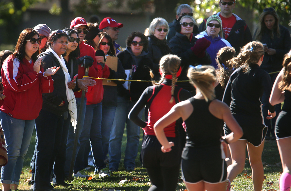 Spectators, including coaches, watch the girls race from the sidelines Saturday morning. David Spencer/The State Journal-Register