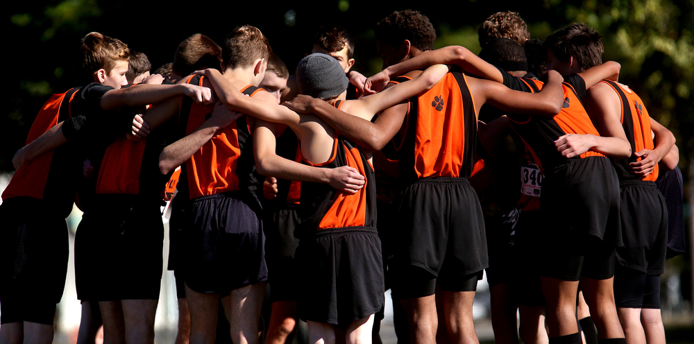 Members of the Lanphier High School boys team, who ended up finishing fifth as a team during the meet, huddle together before the start of the race on Saturday. David Spencer/The State Journal-Register