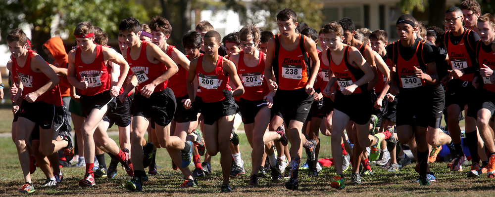 Lanphier and Springfield High School boys runners take off from the start line for the three mile race Saturday. David Spencer/The State Journal-Register