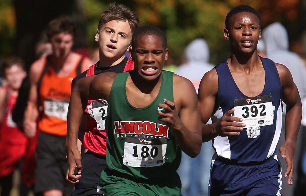 A Lincoln runner leads the way while in a tight pack at the finish with a Springfield Southeast and Springfield High School runner. David Spencer/The State Journal-Register