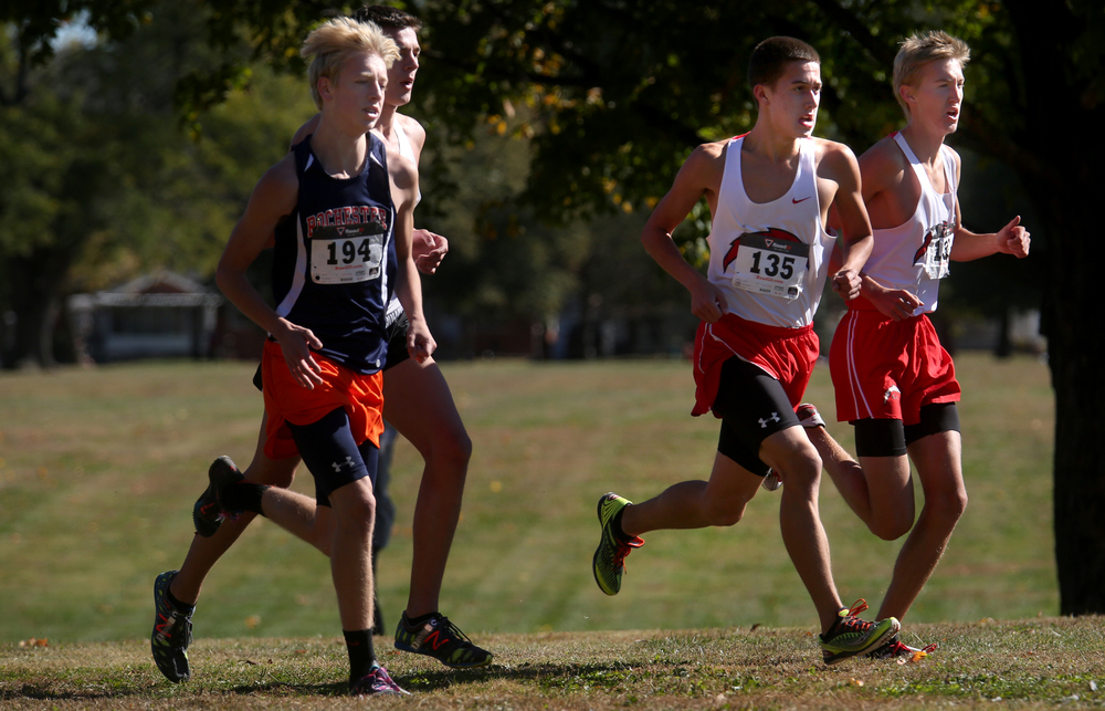 Some of the top boys competitors are seen at the 1.5 mile mark of the race on Saturday. David Spencer/The State Journal-Register
