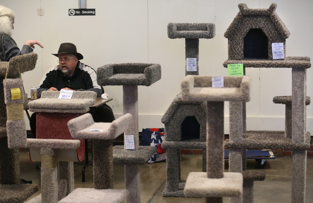 "Among the elaborate carpeted feline perches displayed for sale at the show was a Kitty ""Kommand Post"" seen in back at far right which had a sale price of $199.99. David Spencer/The State Journal-Register"