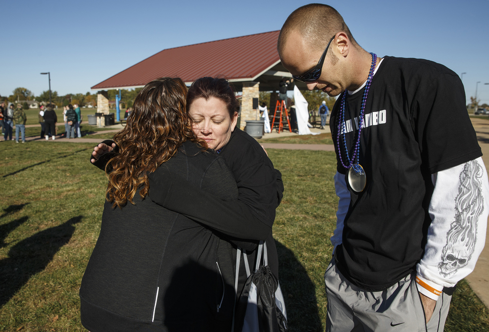 Rachel Patarozzi hugs Julia Hunter after the Out of the Darkness Springfield Community Walk benefiting the American Foundation for Suicide Prevention Illinois Chapter at Southwind Park Saturday, Oct. 17, 2015. Hunter's longtime companion Andrew Estill committed suicide in August. Ted Schurter/The State Journal-Register